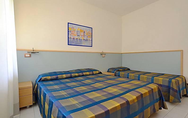Dormitorio Udine ~ Apartamento para 7 personas con piscina Lignano Sabbiadoro (Udine) Alpes italianos