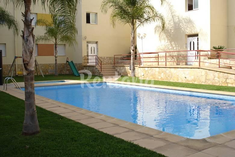 Apartamento con piscina 120m playa les cases d 39 alcanar for Apartamentos jardin playa larga tarragona