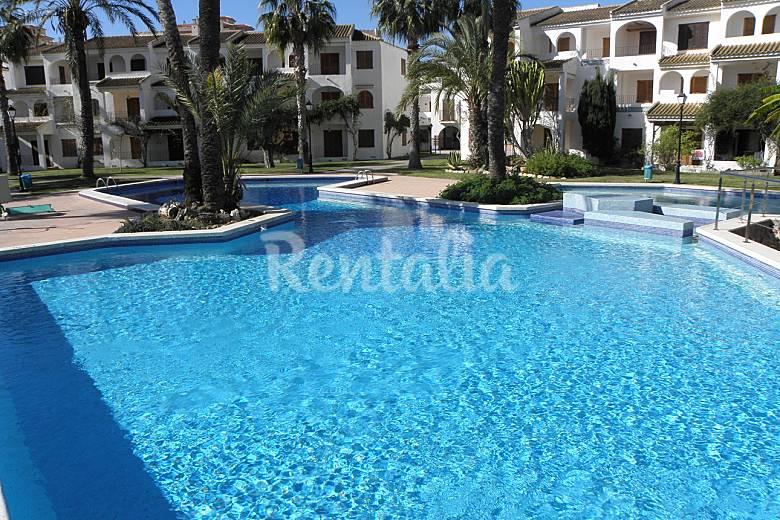 Apartamento en complejo con 2 piscinas la manga del mar for Complejo rural con piscina