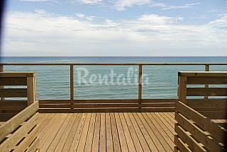 Apartamentos com 1 quartos em frente à praia