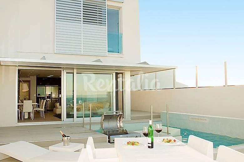 Apartamento en alquiler con piscina cap blanc cullera for Apartamentos con piscina en valencia