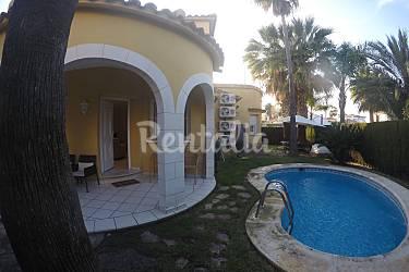 Villa piscina jard n wifi digit oliva playa oliva for Piscina jardin valencia